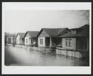 Flooding of cottages in the Holy City barrio.