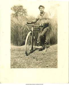 Herman Glenn Rodriguez with bicycle, Bettendorf, Iowa, 1925