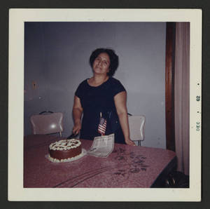 Mary Terronez with citizenship papers and cake, 1962.<br />