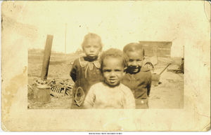 Left to right, Estefania Joyce, Richard, and John Rodriguez near the boxcars, Holy City, Bettendorf, Iowa, 1927