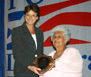 Governor Sally Pederson presents Mary Campos with the Minnette Doderer Award
