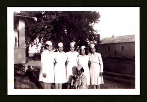 Blanca Vasquez (2nd from left) and Heriberta Casablanca (front), Albia, Iowa, 1945
