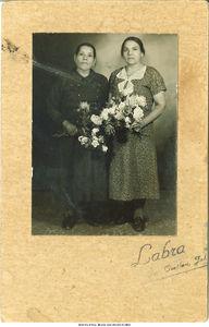 Estefania and Camila Rodriguez holding flowers, Mexico, 1940s?