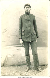 Adolphus Glenn standing outside, 1900s?