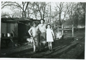Joe Gomez, Cecilia Nunez and Tillie Gomez in front of their Cook's Point home, ca. 1945.
