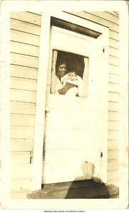 Photograph of Muggie Adams Rodriguez holding daughter Estefania Joyce Rodriguez, 1923